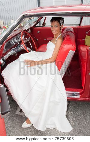 Happy Caucasian Bride in a red car