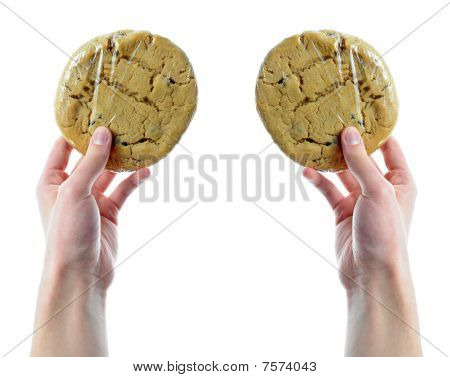 Hands Holding Plastic Wrapped Cookies