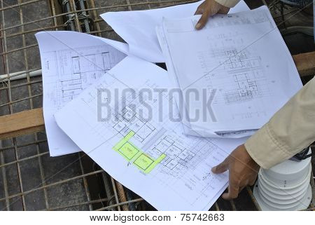 Construction worker referring to the construction drawing