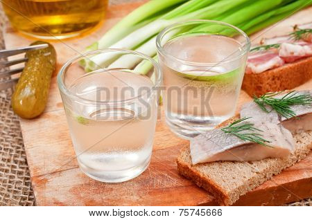 Two Glasses Of Vodka And A Snack