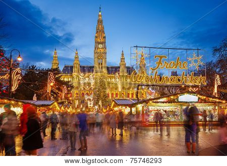 Rathaus and christmas market in Vienna, Austria Translation: Merry Christmas