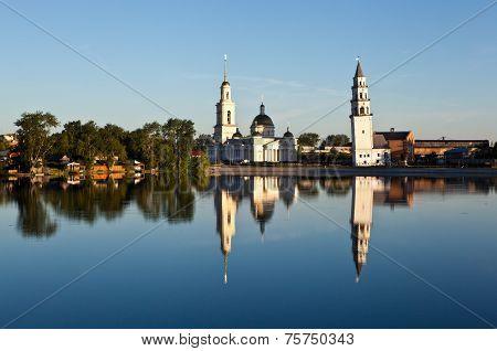 Nevyansky pond, Spaso-Preobrazhensky Cathedral and leaning tower Demidov. Nevyansk. Sverdlovsk regio