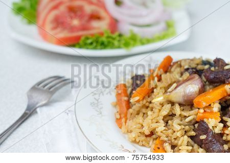 National pilau rice with beef served on a round plate