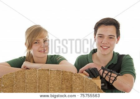 Girl And Boy Behind Archery Target