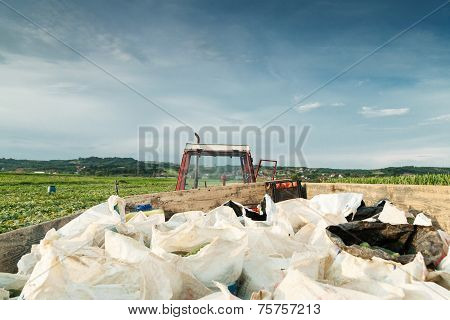 tractor charged with harvesting bags