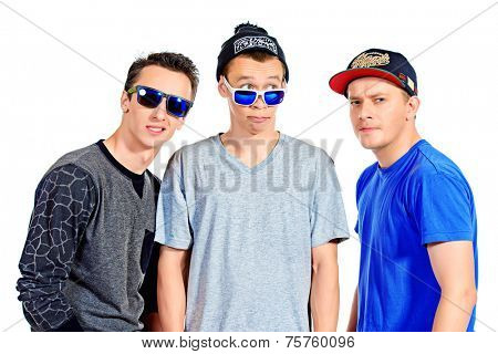 Three funny guys friends standing together. Different emotions. Isolated over white.