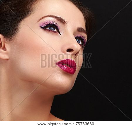 Chic Model With Bright Face Makeup With Long Lashes Looking Up