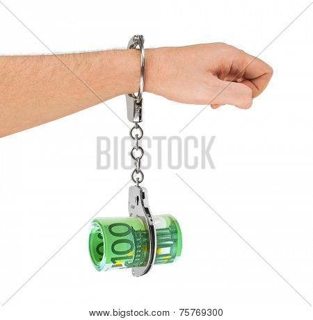 Hand with handcuffs and money isolated on white background