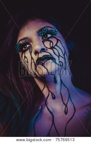 violence concept, crying woman with tears and makeup dark light