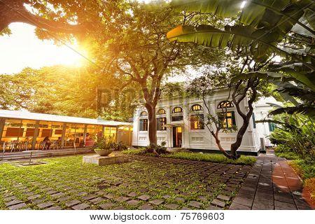 scene of restaurant front yard in sunset