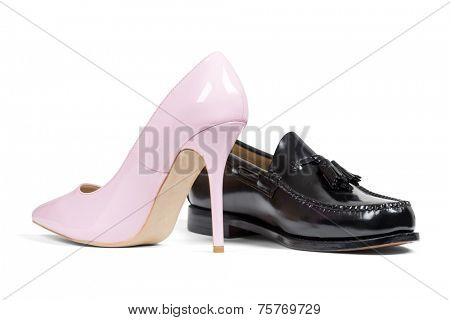 Luxury man's shoe and pink women's heel shoe isolated over white with clipping path.