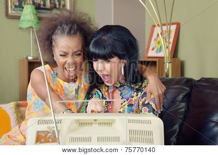 Pair Of Ladies Laughing At Tv