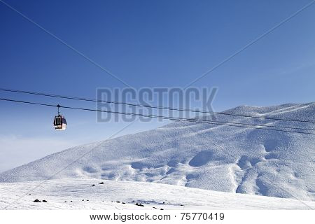 Gondola Lift And Ski Slope At Nice Sun Day