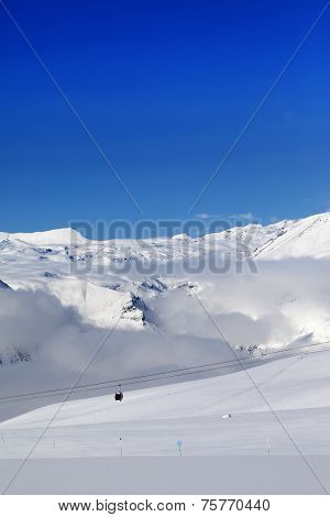 Winter Snowy Mountains And Ski Slope At Nice Day
