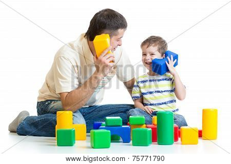 dad and kid boy role-playing together