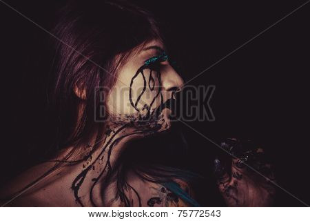 concept, crying woman with tears and makeup dark light