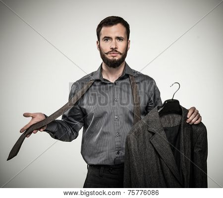 Handsome man with beard choosing tie