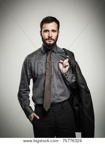Handsome man with jacket over his shoulder