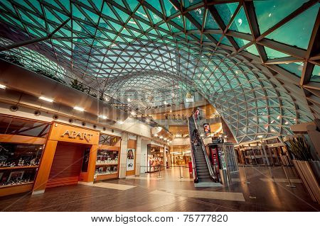 WARSAW, POLAND - NOV 1: The shopping mall, called Golden Terraces, with modern architecture at night in Warsaw, Poland on November 1, 2014. It is a major mall next to the central station.