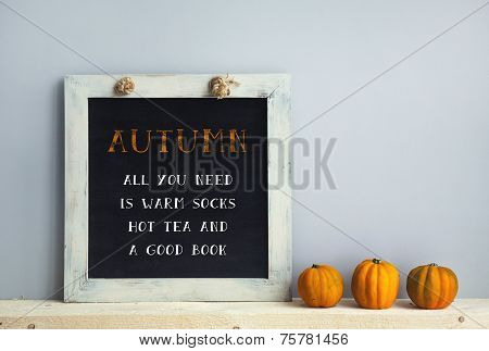 Chalkboard Frame On The Grey Wall With Books  Pumpkins Autumn - Alll You Need Is Warm Socks, Hot Tea