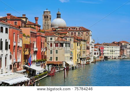 VENICE, ITALY - APRIL 13: View of the Grand Canal from Ponti degli Scalzi bridge on April 13, 2013 in Venice, Italy, with the belfry and the dome of the Chiesa di San Geremia church in the background
