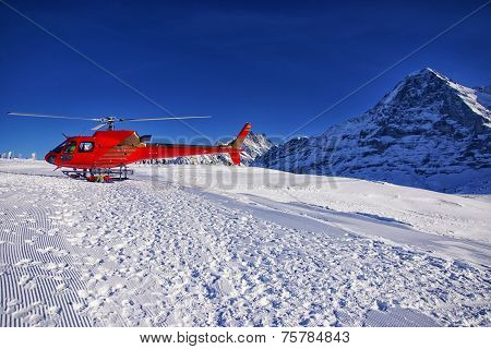 Red Helicopter At Swiss Alps Ski Resort Near Jungfrau Mountain