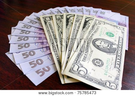 Dollars And Grivnas Banknotes On The Dark