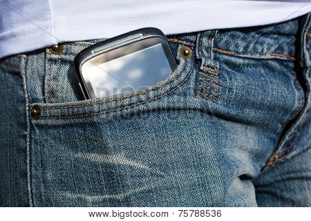 Woman With Smartphone In Her Pants Pocket