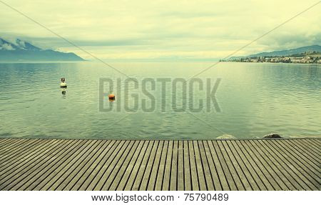 Empty Gray Wooden Pier On Lake Geneva