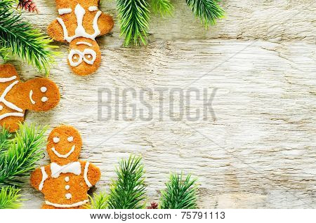 Ginger Biscuits And A Branches Of A Christmas Tree