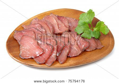 Jamon Cured Pork Meat Sliced On Wooden Plate, Over White.