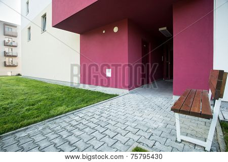 Bench In Front Of Residential Block