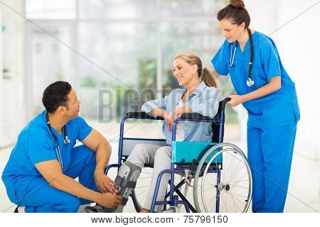 friendly doctor talking to a recovering patient in wheelchair