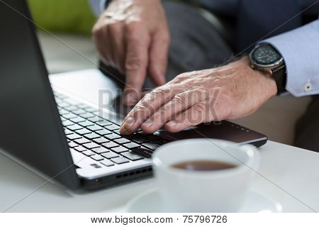 Close-up Of Using The Laptop