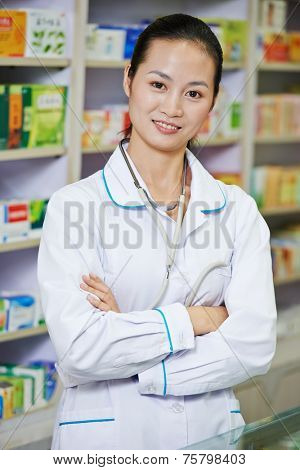 chinese pharmacist chemist woman standing in china pharmacy drugstore