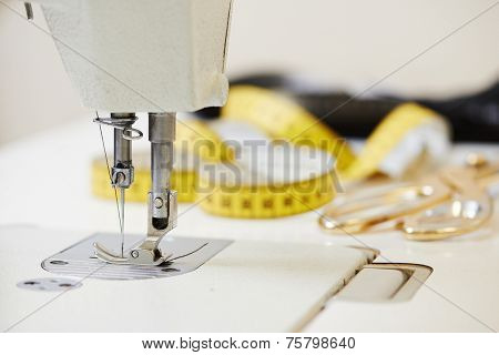 Tailor or sewing set. Cloth, machine, scissors, measure tape