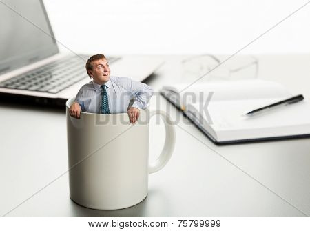 Astonished man in white cup