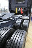 image of asymmetric  - a shot of tires of new trucks - JPG