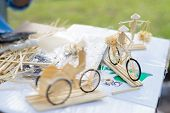pic of wood craft  - Traditional vietnam crafts using soft wood to make a worker farmer ride on a little bicycle - JPG
