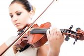 image of violin  - Beautiful young woman playing violin over white background - JPG