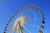 stock photo of carnival ride  - Ferris wheel with clear blue sky in carnival festival