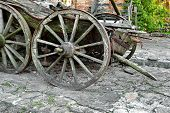pic of antique wheelchair  - Old Cart and cartweels on the country backyard - JPG