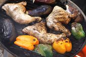 image of thigh highs  - fresh group of grilled chicken thighs with green orange yellow pepper bell slice and eggplants on hot grill bbq high resolution - JPG