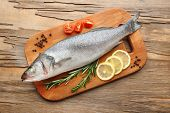 pic of frozen food  - Fresh raw fish and food ingredients on table - JPG