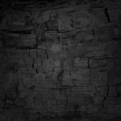 picture of charcoal  - black uneven background with charcoal texture and copy space - JPG