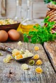 picture of italian parsley  - raw pasta in a spoon vegetable oil parsley and eggs on old wooden table. italian cuisine.  ** Note: Shallow depth of field - JPG