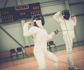 pic of rapier  - Two women fencers on a training  - JPG
