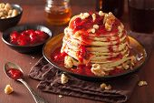 stock photo of walnut  - stack of pancakes with strawberry jam and walnuts - JPG