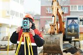 image of theodolite  - One surveyor worker working with theodolite transit equipment at road construction site outdoors - JPG