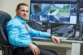 picture of supervision  - security executive chief in front of video monitoring surveillance security system - JPG